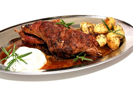 tzatziki: Lamb chop with potatoes and tzatziki Stock Photo