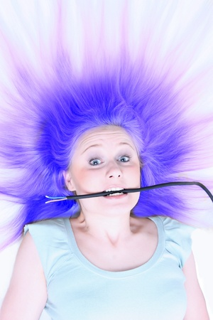 electricity prices: girl under electric shock Stock Photo
