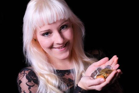 argentum: Girl with silver and gold coins Stock Photo