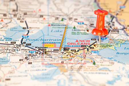 Closeup of New Orleans, Louisiana on a map with a red push pin marking the city
