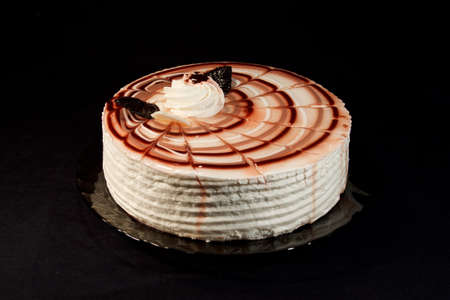 cake on a plate on a black background Stock Photo