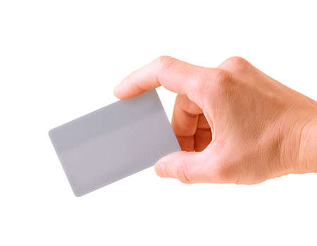 hand with a debit card isolated on white background