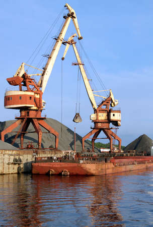 Two dock clamshell crane and barge