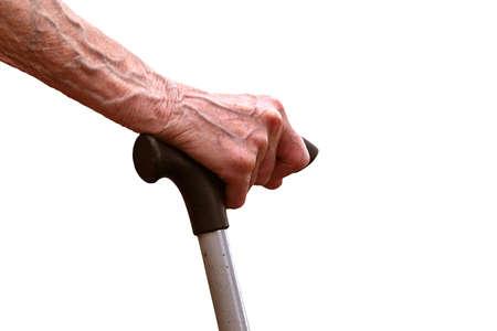 hand an elderly woman resting on a stick