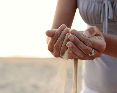 Time as the sand slips through your fingers. Stock Photo - 10985370