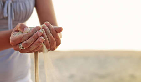 Time as the sand slips through your fingers.. Stock Photo