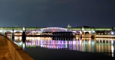 The pedestrian bridge over the river.