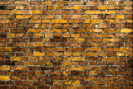 Brick wall. Vintage texture in yellow brown tones.