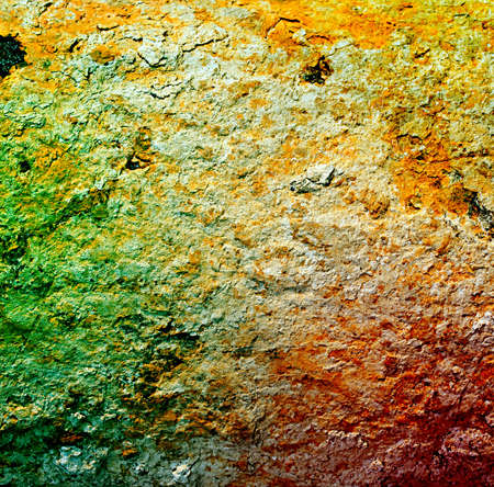 Rust Grunge textured background under a layer of clay with shades of green, red, yellow.