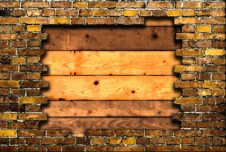 brick frame with background of planks Standard-Bild
