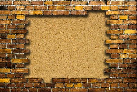 brick frame with background of sand Standard-Bild