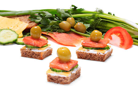 Light and tasty snack of bread, cheese, smoked salmon and olives  With a depth of focus across the frame