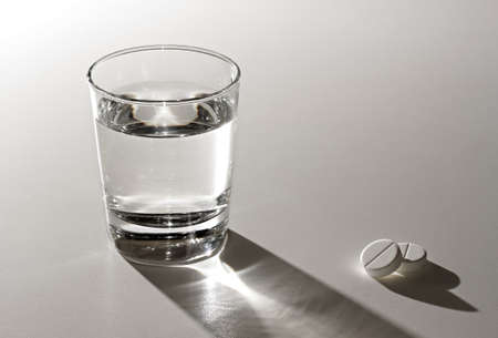 Glass of water and aspirin.