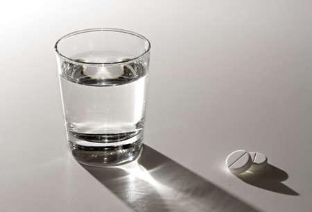 hangover: Glass of water and aspirin. Stock Photo