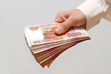 ruble: a bundle of money in the hand of a man