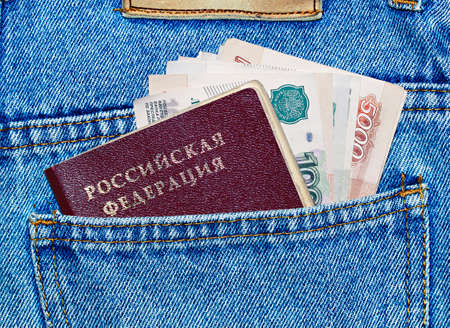 ruble: money and passport in the back pocket of jeans