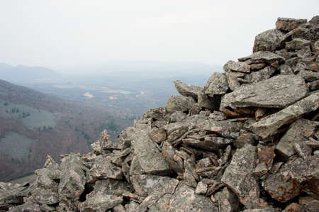 rocky hillside overlooking the river valley photo