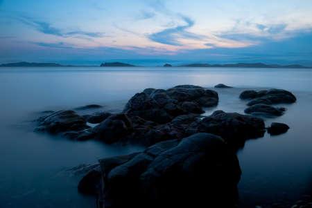 blue dusk seascape, stones on the foreground photo