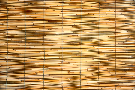 texture of an orange mats made ​​of bamboo and rope photo