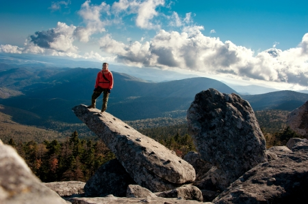 young girl standing on the cliff of mountain Pidan Stock Photo