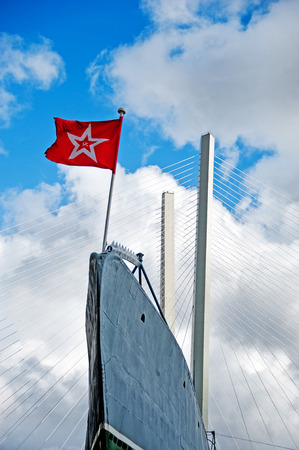 prow: prow of submarine c-56 in Vladivostok with USSR flag and golden bridge behind it Stock Photo