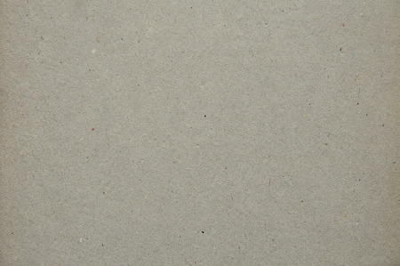 granular: grey granular texture of recycled cardboard, shot close-up