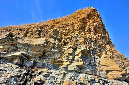 aiguille: beautiful yellow cliff of sharp sandstone with aiguille