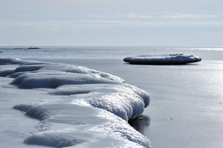 icy shore, single ice floe near the icy shore, cold icy sea