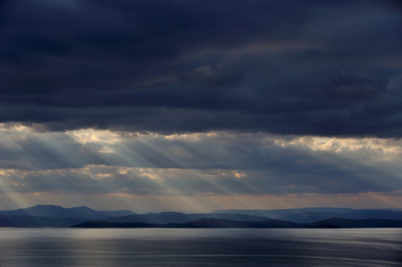 dark low stormy clouds above the sea,