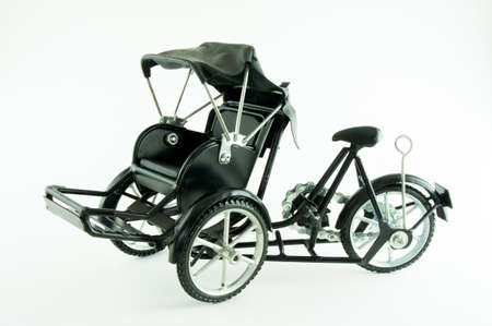 three wheeler: black tricycle