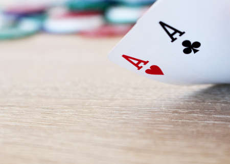 aces: Poker hand with two aces and chips