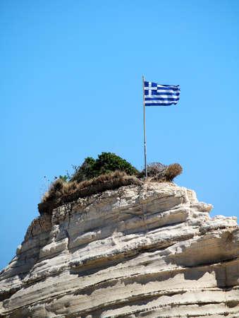 spar: Greece flag on the cliff at the sea