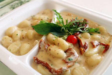 Restaurant lunch menu with tasty gnocchi and sauce