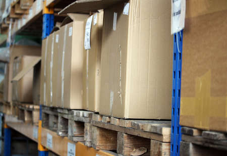 Cardboards with products in the big warehouse Reklamní fotografie