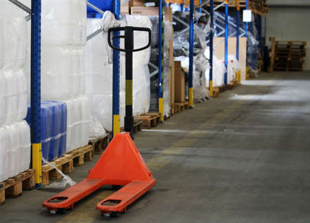 Orange pallet truck for package in the warehouse Reklamní fotografie