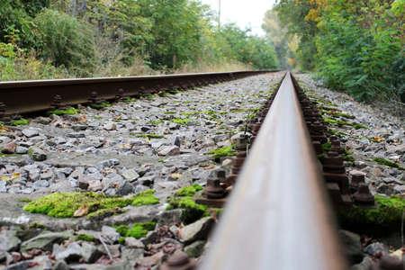 Infinite abandoned steel rail track without train Reklamní fotografie