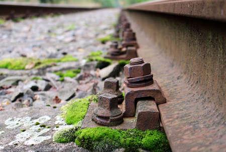 Detail of rail screw at abandoned train track Reklamní fotografie