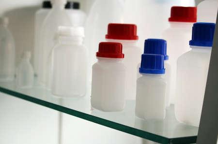 White laboratory plastic bottles for a medicine