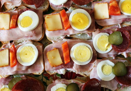 Party sandwiches with ham, cheese, egg and pepper Reklamní fotografie