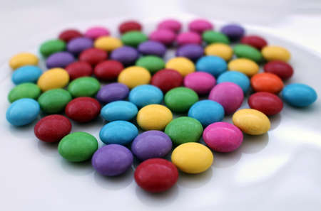 Group of many colorful tasty chocolate smarties