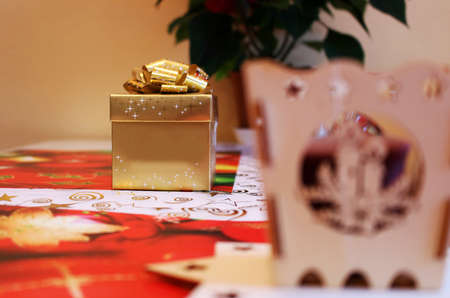 Golden christmas gift box with surprise inside