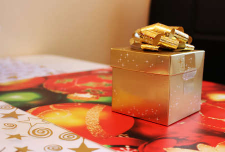 Golden christmas gift box with wrapped surprise