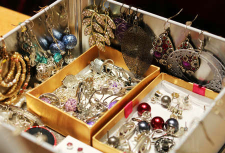 Box full of womens jewelry and earrings