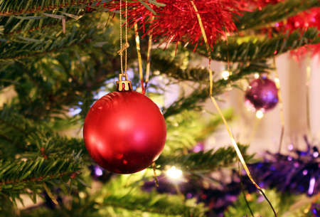 Christmas tree with a bright red decoration