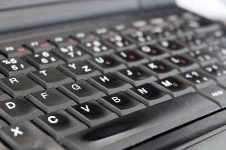 Detail of black laptop keyboard at office