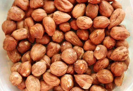 Tasty and healthy hazelnuts in bowl from above