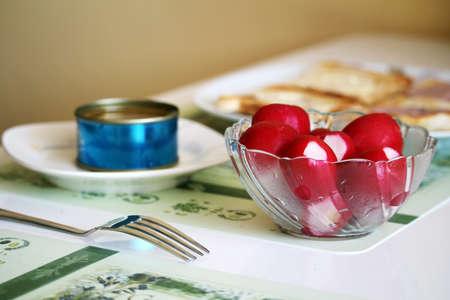 Healthy food with radish, tuna and toast