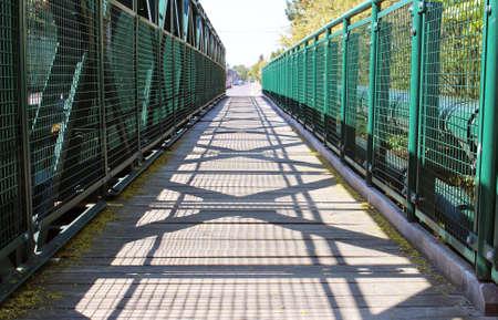 Empty walking road across the green bridge