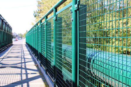 metal handrail: Detail of green railing at empty bridge
