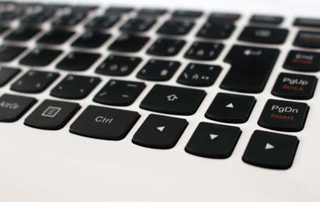 black arrow: White laptop keyboard with black arrow buttons Stock Photo